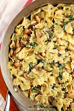 One Pot Creamy Mushroom Spinach Pasta with Beans - a super easy vegetarian dinner idea for the busy day. It all cooks in one pot in just 15 minutes!