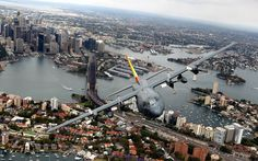 An RAAF C-130H Hercules aircraft performs a flyover of Sydney Harbour  Picture: Newspix / Rex Features