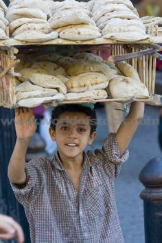 Boy Selling Fresh Bread On The Streets In Islamic Cairo Egypt,