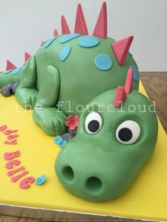 A gorgeous green dinosaur with blue spots and red spikes. Happy birthday!