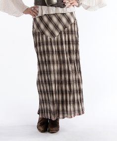 Perfect for the confident, style-savvy woman, this maxi skirt boasts classic plaid from hip to toe. The pure cotton material makes it a pleasure to wear.