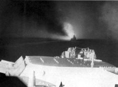 View forward from the USS Columbia (CL-56) during the Battle of Empress Augusta Bay. The ship visible ahead should be USS Cleveland (CL-55).