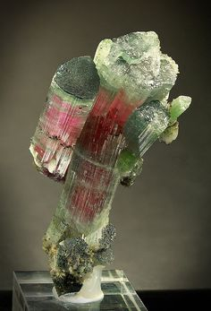 Rainbow Tourmaline. What a lovely specimen. Lovely for healing love issues of all kinds--romantic, friendship or spiritual. Www.arielhubbard.com