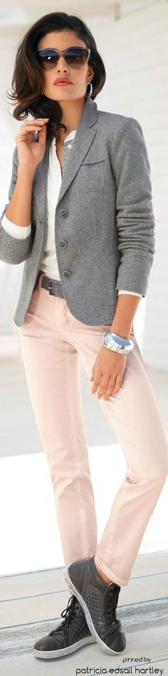 Grey structured blazer styled with pink jeans and a crisp white shirt
