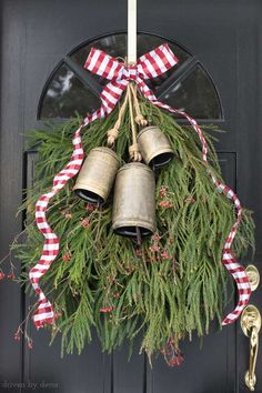 Our front door Christmas decoration - a greenery swag with bells and ribbon instead of a wreath! #christmas #wreath #door #porch #swag #greenery #ribbon