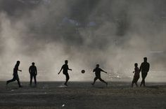 Afghan boys are silhouetted as they play football while the sun sets in Kabul November REUTERS/Mohammad Ismail Pure Football, Football Is Life, Football Soccer, Football Stuff, Football Season, Soccer Art, Soccer Poster, Soccer Boys, Football Training Program