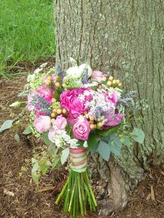 Rustic bouquet of pinks, peach, and lavender for a rustic bride by WhimsicalWelcomes.com Collegeville, PA