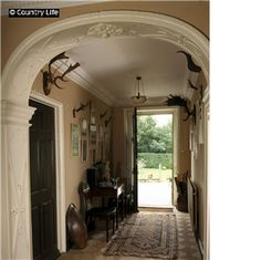 The view of the hall at Beckside House. I love the arch!