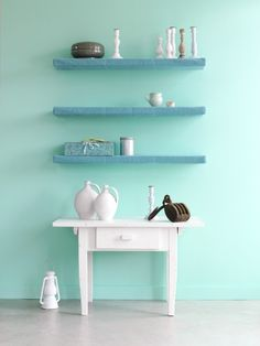Mint walls and blue shelves.