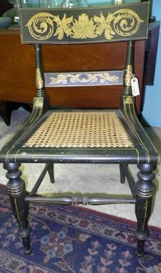 in what kind of world do we live where this brings only 34.50? FURNITURE HITCHCOCK STYLE BALTIMORE CHAIR, ORNATE PAINTING, CANE BOTTOM SEAT - Rasmus Auctions, 4/25/12 Yes, thirty four fifty.