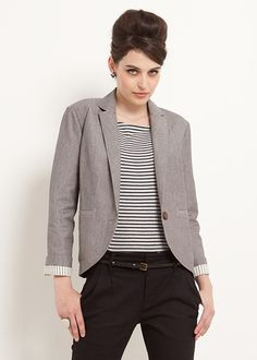 Sophia Tuxedo Jacket. Versatile office to evening single lapel blazer in grey hand woven chambray with smart pin stripe turn-up cuffs. Front pockets and vent in reverse. Fastened with a coconut button. Hand woven in Bangladesh in 100% cotton.