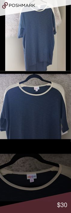 "NWT LuLaRoe Irma Striped Ribbed Blue Cream XS Top NWT LuLaRoe Irma t shirt.  Size extra small.  Navy blue with cream on shoulders and back of arms.  Lightly ribbed, giving the appearance of stripes.  High low.  Mid length sleeves.  28% polyester, 68% cotton, 4% spandex.  Machine wash.  Hang dry.  Measures 24"" pit to pit, 32"" shoulder to hem.  New with tags! LuLaRoe Tops Tees - Short Sleeve"