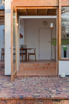 The external walls of the extension are finished in a pale pink, textured render relating to but also consciously different to the finish on the existing house. Internally the materials are natural and earthy - again connecting to the garden; the walls use a finer textured version of the external render. The terracotta tiled floor allows a soft demarcation between inside and out.