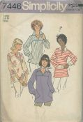 An original ca. 1976 Simplicity Pattern 7446.  Misses' Pullover Tops: The top-stitched top V. 1 stitched to yoke and sleeves has front slit opening, collar, long kimono sleeves gathered to buttoned cuffs and pockets in side seams. Top-stitched top V. 2 with front slash opening has lowered round neckline and below elbow length set-in sleeves.
