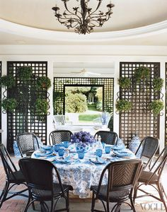 D. Porthault linens and Mottahedeh Tobacco Leaf china in Tory Burch's poolhouse dining rotunda