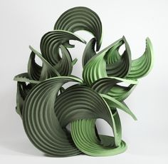 """Green Waterfall"" by Erik and Martin Demaine (2011), 18"" x 11"" x 19"" high. Origami sculpture made from Mi-Teintes watercolor paper."