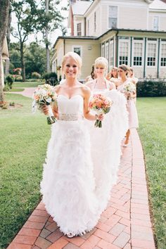 Love this feathery wedding dress! Photography by inContrast Images | incontrastimages.com, Floral Design by Bouquet Floral Design | bouquetfloraldesign.com, Read more - http://www.stylemepretty.com/2013/06/19/charlotte-wedding-from-incontrast-images/