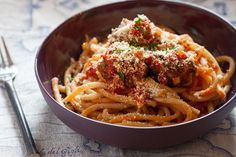 """Perciatelli Pasta  with Red Quinoa """"Meatballs"""".28 Ounce Can Whole Peeled Tomatoes 4 Cloves Garlic 1 Bunch Thyme 1 Bunch Parsley 1 Egg 1 Onion 6 Ounces Perciatelli Pasta ½ Cup Red Quinoa ¼ Cup Whole Wheat Flour ⅓ Cup Grated Parmesan Cheese 1 Bunch Oregano"""