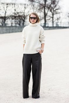 off-white turtleneck sweater and wide-leg leather pants
