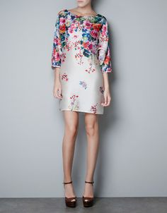 Floral Print Tunic @ Zara. I absolutely LOVE this tunic...it hangs as a dress on my petite frame but the floral pattern is exquisite. Add a pair of nude high heels to perfect your outfit.