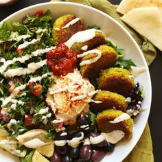 The ULTIMATE Mediterranean Bowl with hummus, falafel, tahini sauce, olives and pita! #vegan #glutenfree #falafel #recipe #healthy #easy