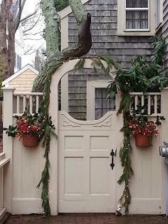 How inviting is this beautiful gate?  Its charming details go well with the home design, and its open circular top provides a glimpse inside.  We love gorgeous gates - if you live in the Minneapolis MN area, we can design a #Landscape plan that includes something like this. http://www.aldmn.com