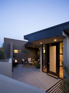 There it is, frosted door and clear side windows .sleek and modern front door and soffit lighting.from Raul Garcia