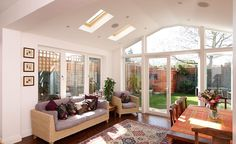 Extension with gable end, roof windows and garden view