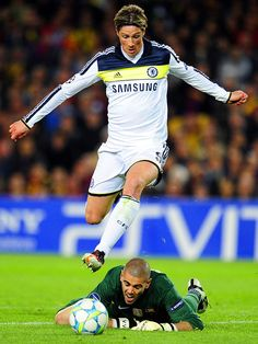 Victory Dance - Chelsea forward Fernando Torres, top, vies for the ball with Barcelona goalkeeper Victor Valdes before scoring during the UEFA Champions League second leg semi-final match at the Cam Nou stadium in Barcelona, Spain.