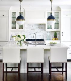 White kitchen: 1) white recessed panels, 2) white Quartz counter, 3) Calacatta Gold subway tiles. 4) for hardware use rubbed bronze. 5) nailhead trim for upholstered banquette. 6) not these lights.