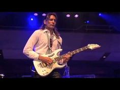 "Guitarist Steve Vai performs - ""For The Love of God"" - live with the Holland Metropole Orchestra, 2005, featuring orchestration by Chris Opperman."