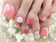 Pink and white pedicure design
