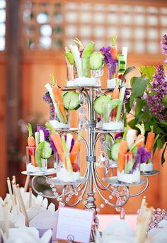 Individual veggies and dip set in a cupcake display