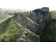 A fantastic castle rumored to be the birthplace of King Arthur, Tintagel Castle stands on windswept cliffs in North Cornwall overlooking the Atlantic Ocean.