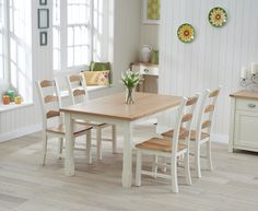 Buy the Somerset 130cm Oak and Cream Dining Table with Chairs at Oak Furniture…