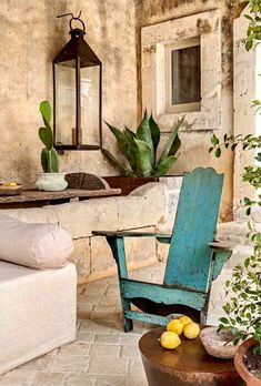 Rustic European styled outdoor seating with washed out turquoise chair. Outdoor Rooms, Outdoor Living, Outdoor Decor, Outdoor Seating, Patio Interior, Interior Design, Deco Nature, Stone Houses, Rustic Design