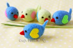 Turn simple felted eggs into bunch of little birds by adding embellishments on them with needle felt method.
