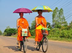 """""""Cycling Monks with umbrellas"""""""
