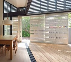 House Reduction by Make Architecture Studio.Timber batten screens can be moved to track the sun