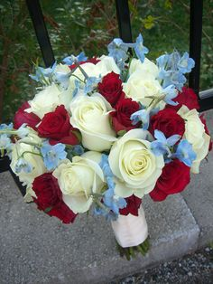 Color scheme of my bouquet - different flowers though...red roses, blue hydrangea, white calla lilies, and the white filler flower from my bridesmaids bouquets! Bridesmaid bouquets will be red roses, white hydrangea, and a blue filler flower. :) SUPER EXCITED!!