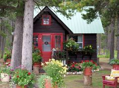 small black house with red door and tin roof love cottage style homes ...