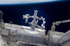 This is the Canada's multi-talented robot docked to the International Space Station eleven years ago, with the purpose of conducting science experiments in the vacuum. Station Eleven, Universe Today, Nasa Images, International Space Station, Space And Astronomy, Hubble Space, Image Of The Day, Science Experiments, Outer Space