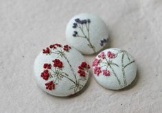 embroidered buttons - these would make cute magnets