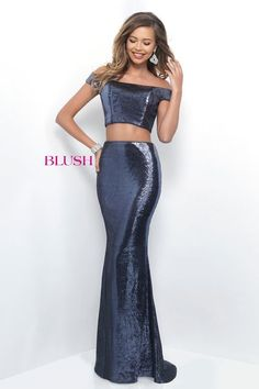 Sultry all sequin two piece that features a portrait neckline with cap sleeves and a high waisted skirt in a fitted column silhouette. This style is complete with a sweeping train. Back zipper closure.