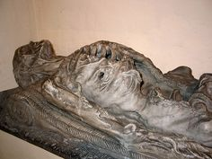 Sculpture of l'homme à moulons (french expression for cadaver eaten by worms). 16th century in Boussu, Belgium.