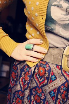 nice combination. patterned skirt, polka dotted cardigan, and vintage tee shirt