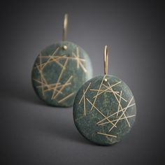 """""""Undone Earrings"""" were inspired by a very short lived work created by artist Andy Goldsworthy where he assembled an inverted nest-like structure out of driftwood that was lifted and slowly deconstructed by the tide- seen in the documentary Rivers and Tides. Inlaid reclaimed 18k gold, floats and disperses in a sea of green."""