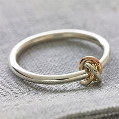 An elegant handmade solid sterling sliver ring detailed with three interlocking small rings in solid White,Rose and Yellow 9ct goldThis ring is also available in silver with a sliver knot, If you wish…MoreMore #SilverNiceJewelry