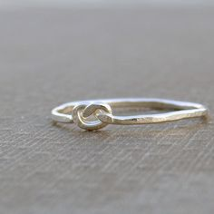 Love knot silver ring, knuckle ring, thumb ring sterling silver, hammered infinity knot ring, stacking ring, delicate ring 18 gauge jetteam. $19.00, via Etsy.