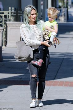 Hilary Duff shows off her hard worked for physique in sexy ensembles #dailymail